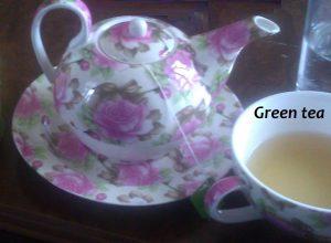kopje groene kruiden thee